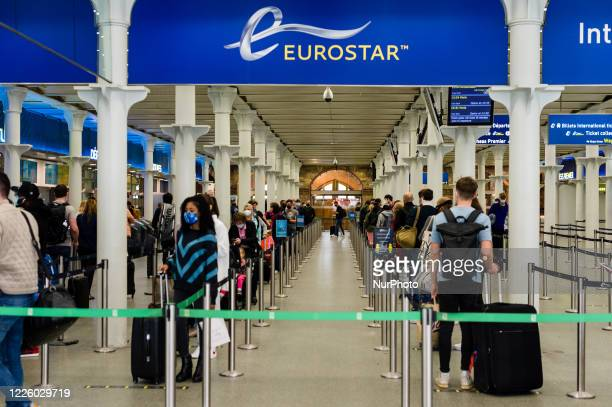Travellers boarding the train in St Pancras International in London, Britain, 10 July 2020. English holidaymakers will be able to visit Spain, Italy,...