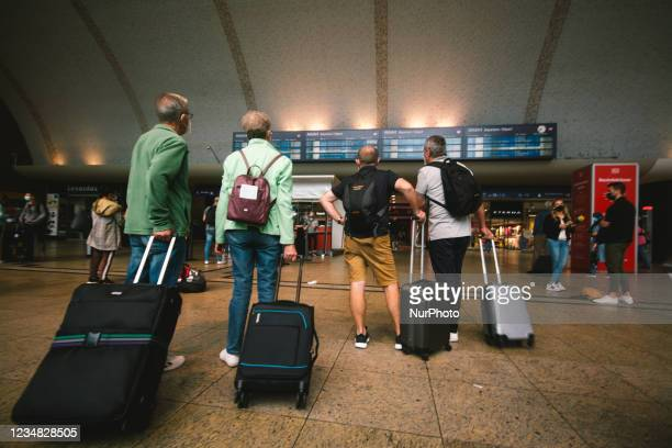 Travellers check the departure information in Cologne Central station, Germany on August 23, 2021 as GDL train union starts the second strike till...