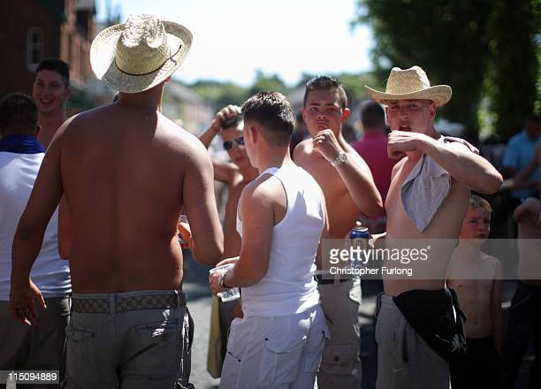 Travellers enjoy the sunshine outside a village pub at the Appleby Horse Fair on June 3 2011 in Appleby England Appleby Horse Fair has existed under...