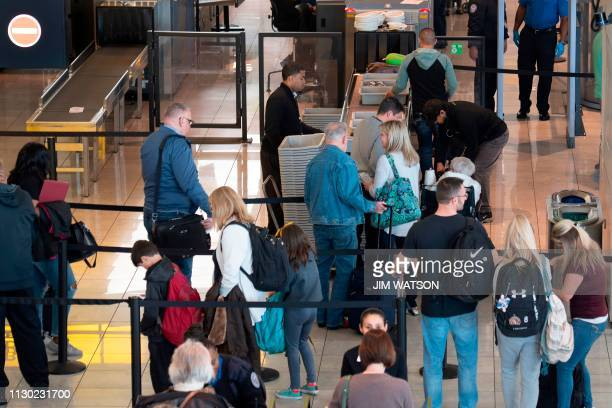 Travellers enter the Transportation Security Administration security checkpoint at Baltimore Washington International Airport near Baltimore,...