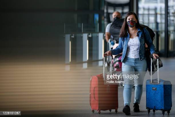 Travellers exit Heathrow Airport Terminal 2 on August 22, 2020 in London, England. As of Saturday morning at 4am, travellers arriving in England from...