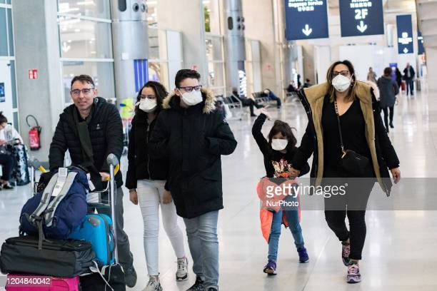 Travellers family wear masks to avoid transmission of coronavirus upon arrival at Terminal 2 of Roissy Charles de Gaulle Airport in Roissy France on...