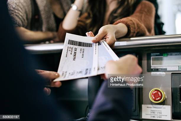 travellers getting boarding passes at check-in - travel stock-fotos und bilder