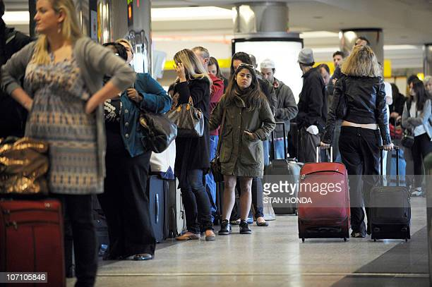 Travellers in a long check-in line caused by a computer malfunction at Spirit Airlines November 24, 2010 at La Guardia Airport in New York on what is...