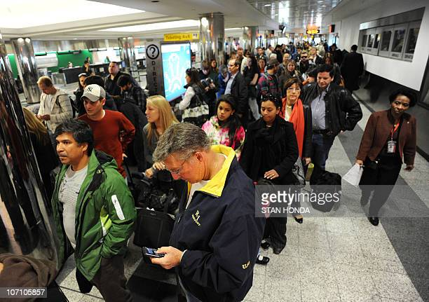 Travellers in a long checkin line caused by a computer malfunction at Spirit Airlines November 24 2010 at La Guardia Airport in New York on what is...