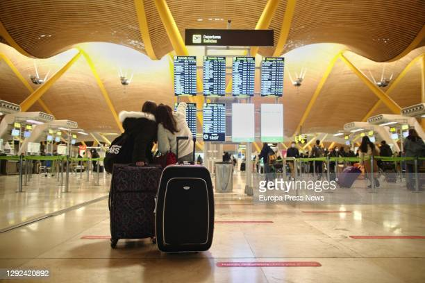Travellers in the arrivals area of T4 terminal at Adolfo Suárez Madrid-Barajas Airport, one day before the suspension of flights from the United...