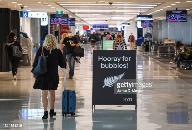 Travellers in the International departures lounge at Sydney Airport before departing for New Zealand on April 19, 2021 in Sydney, Australia. The...