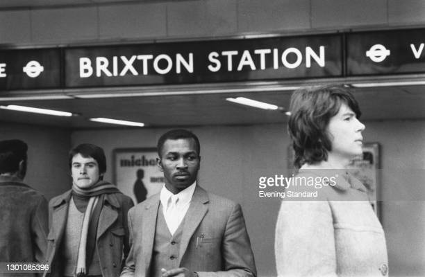 Travellers leaving the Victoria Line at Brixton Station in south London, UK, 19th February 1973.