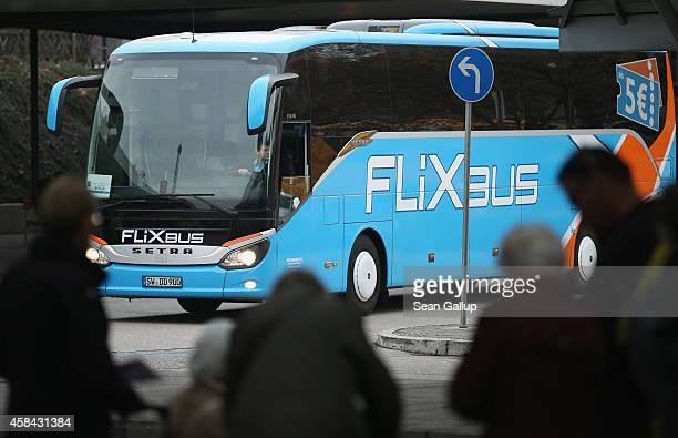 Travellers look on as a bus operated by Flixbus arrives at the central bus station on November 5 2014 in Berlin Germany Bus companies in Germany are...