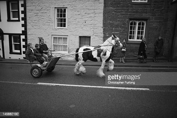 Travellers parade their horse though Appleby at the Appleby Horse Fair on June 7 2012 in Appleby England Appleby Horse Fair has existed under the...
