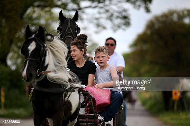 Travellers race their horses along the 'Mad Mile' during the Appleby Horse Fair on June 4, 2015 in Appleby, England. The Appleby Horse Fair has...