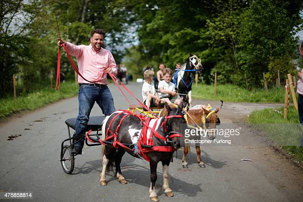 Travellers race their horses along the 'Mad Mile' during the Appleby Horse Fair on June 4 2015 in Appleby England The Appleby Horse Fair has existed...