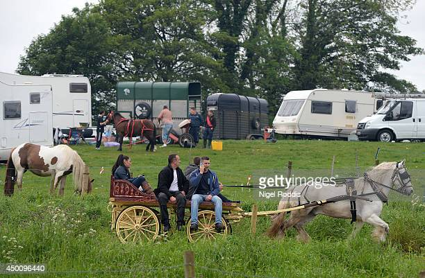 Travellers sit on a horse drawn buggy during the Appleby Horse Fair on June 5 2014 in Appleby England The Appleby Horse Fair has existed under the...
