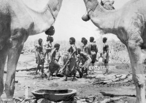 Travellers surround the waterhole at El Wak near the frontier of British and Italian Somaliland 28th October 1935 This well sunk into limestone is...