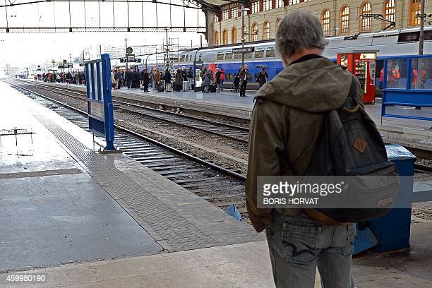 Travellers wait for a train on a platform of the SaintCharles railway station as a strike by ticket inspectors could slightly disturb the train...