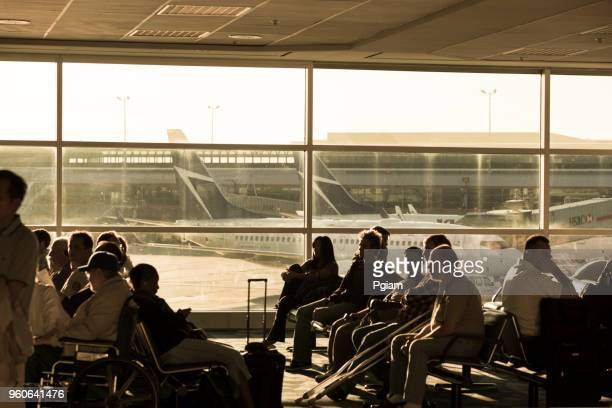 Travellers waiting for flights at the airport