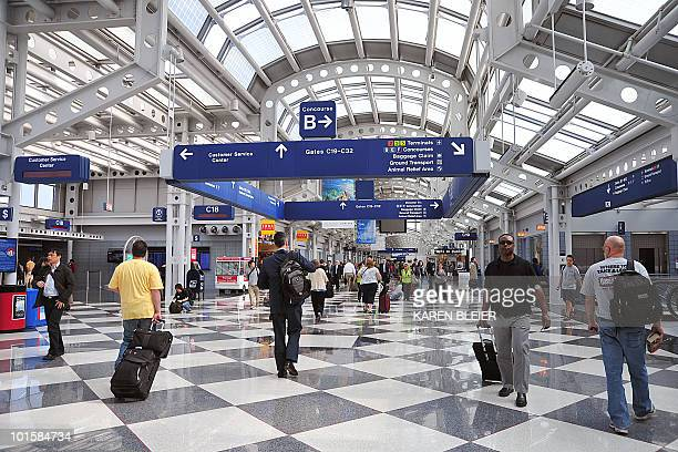 Travellers walk down a concourse at Chicago's O'Hare International Airport in Chicago Illinois on May 25 2010 AFP PHOTO/Karen BLEIER