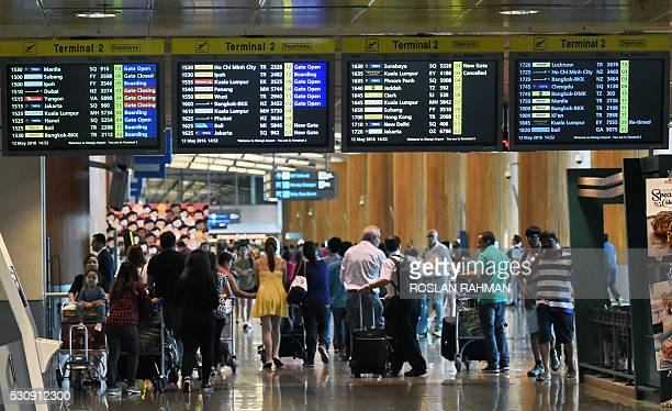 Travellers walk into the departure hall of Singapore's Changi International Airport on May 12 2016 / AFP / ROSLAN RAHMAN