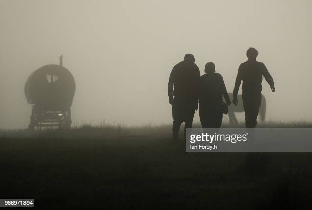 Travellers walk through a fog shrowded campsite on the first day of the Appleby Horse Fair on June 7 2018 in Appleby EnglandThe fair is an annual...