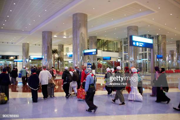 Travellers walking around Dubai International Airport.