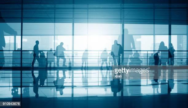 travellers walking in corridor