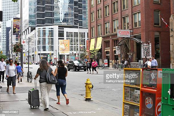 Travellers Walking on Front Street, Downtown Toronto, Canada in Summer