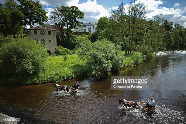 Travellers wash their horses and traps in the River Eden during the Appleby Horse Fair on June 4 2015 in Appleby England The Appleby Horse Fair has...