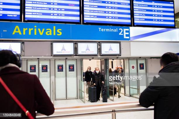 Travellers wear masks to avoid transmission of coronavirus upon arrival at Terminal 2 of Roissy Charles de Gaulle Airport in Roissy France on...