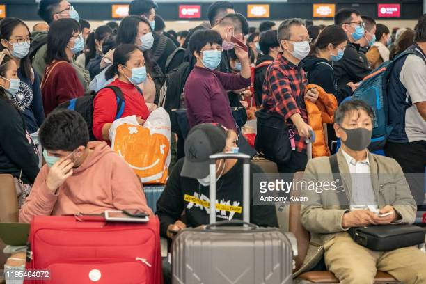 Travellers wearing face mask wait at the departure hall of West Kowloon Station on January 23 2020 in Hong Kong China Hong Kong reported its first...