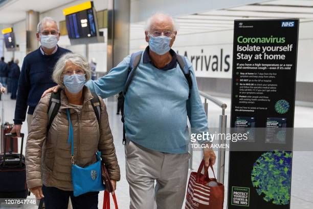 Travellers who had been aboard the Braemar cruise ship operated by Fred Olsen Cruise Lines and wearing face masks as a precautionary measure against...