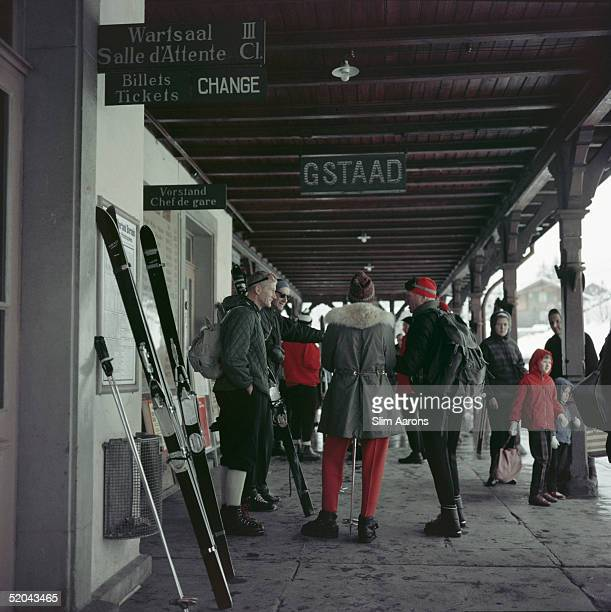 Travellers with their skis waiting at Gstaad Station, 1961.