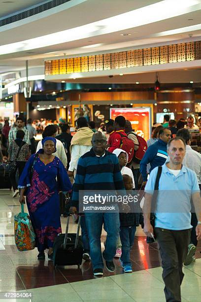 travelling and shopping black people in airport dubai - duty free stock pictures, royalty-free photos & images
