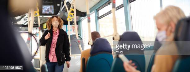 travelling by bus with face mask - sturti stock pictures, royalty-free photos & images