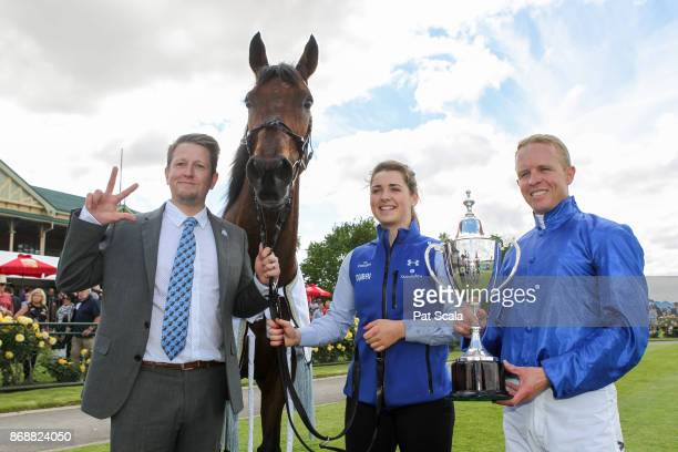 Travelling foreman Chris Connett [L] Kerrin McEvoy [R] and strapper Charlotte Wyatt pose with the trophy and Qewy after winning the Jayco Bendigo Cup...
