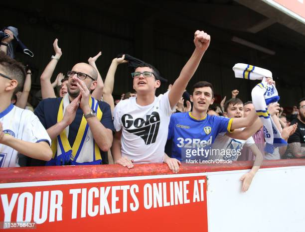 travelling Leeds supporters welcome their team before the match before the Sky Bet Championship match between Brentford FC and Leeds United at...