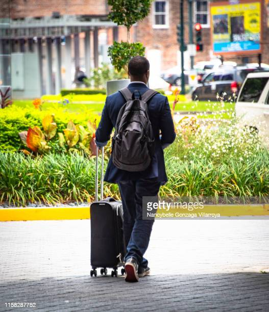 travelling man - nancybelle villarroya stock photos and pictures