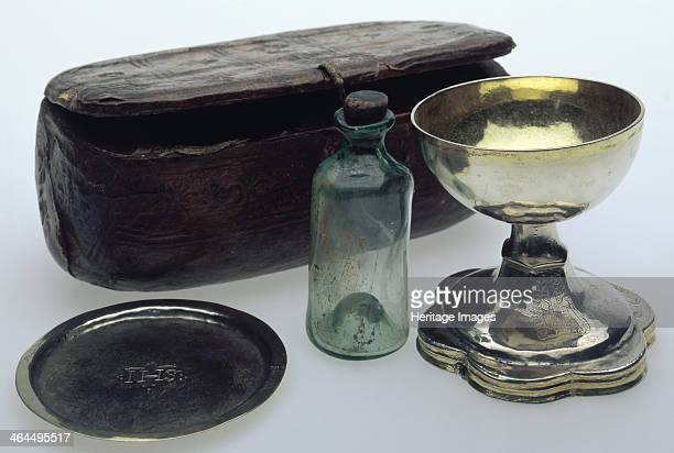 Travelling Mass set c1535 This set consists of a silvergilt chalice paten and a glass bottle for wine with a leather box to carry them in A set such...