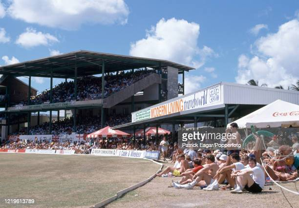 Travelling supporters basking in the sun as they watch the 4th Test match between West Indies and England at the Kensington Oval, Bridgetown,...