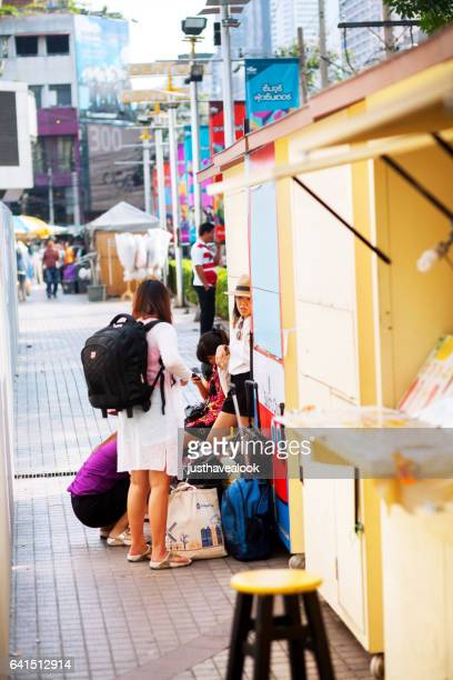 Travelling thai women on sidewalk
