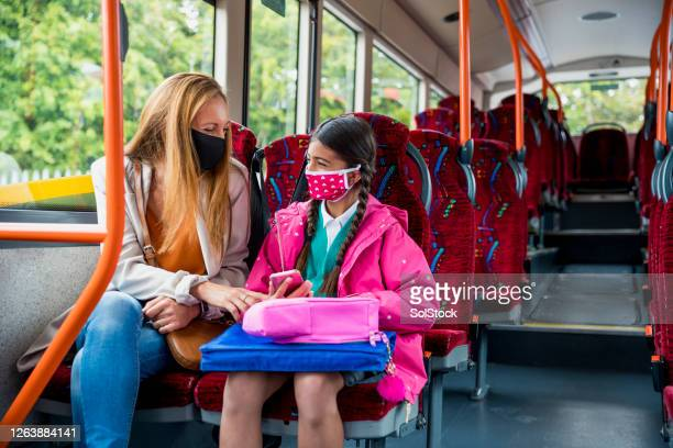 travelling to school during covid 19 - public transport stock pictures, royalty-free photos & images