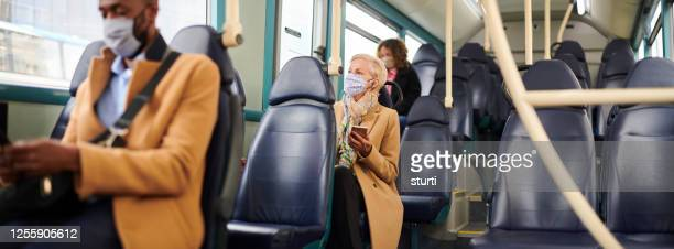 travelling to work safely - text messaging stock pictures, royalty-free photos & images