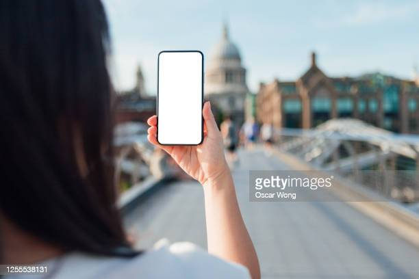 travelling with a smart phone overseas - telephone stock pictures, royalty-free photos & images