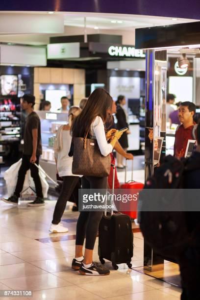 Travelling woman in airport Dubai