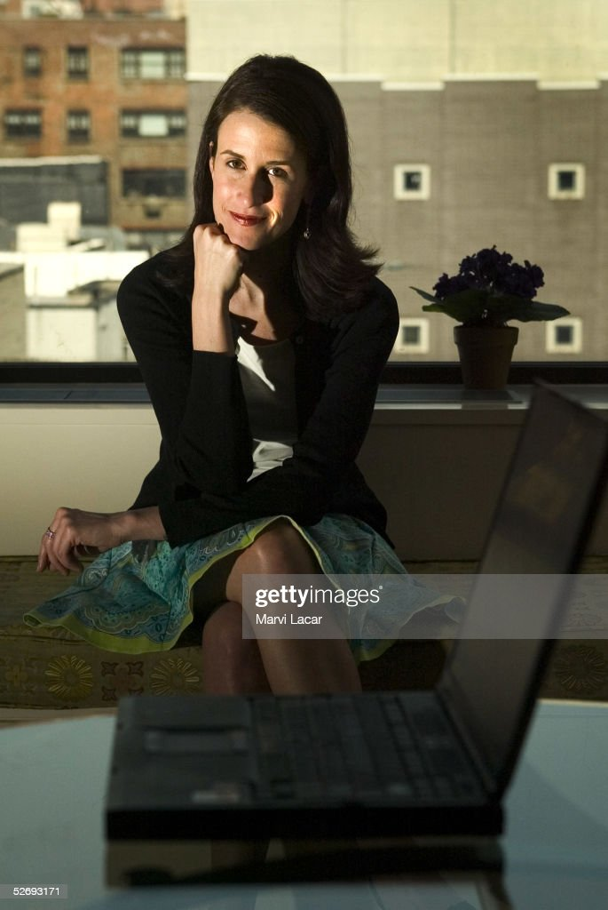 Travelocity CEO Michelle Peluso poses for photos in her apartment in Greenwich Village April 6, 2005 in New York City. Ms. Peluso, 33, is the CEO of Travelocity, the nation's second largest online travel agency.