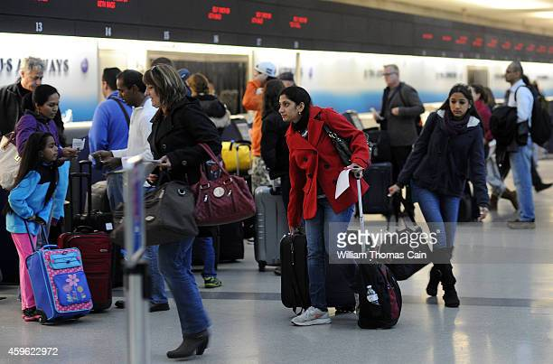 Travels check in for their flights at Philadelphia International Airport November 26 2014 in Philadelphia Pennsylvania A winter storm causes travel...