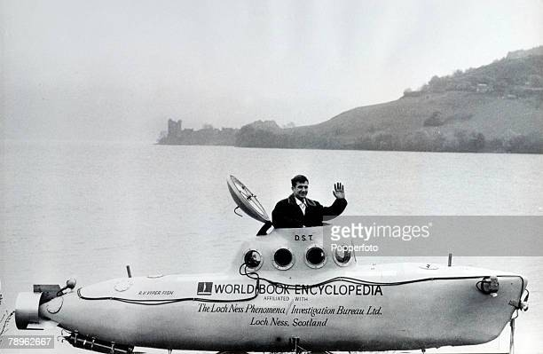 June 1969 American submarine expert Dan Taylor sits in the cockpit of his 20 foot submarine at Loch Ness where he will go underwater to search for...