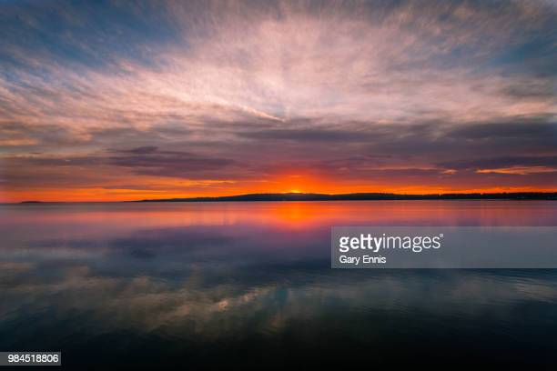 traverse city sunrise - lake michigan stock pictures, royalty-free photos & images