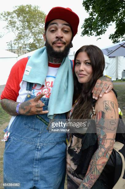 Travie McCoy and Mia Tyler pose backstage at the 2014 Budweiser Made In America Festival at Benjamin Franklin Parkway on August 30 2014 in...