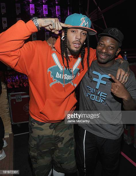 Travie McCoy of Gym Class Heroes and DJ Irie attend Victoria's Secret PINK Hosts PINK Nation Tailgate Party at Virginia Tech on September 14 2012 in...