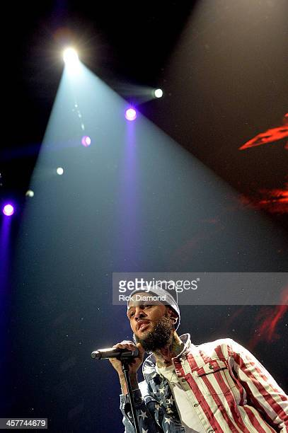 Travie McCoy performs onstage during 933 FLZ's Jingle Ball 2013 at the Tampa Bay Times Forum on December 18 2013 in Tampa Florida
